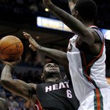 Miami Heat's LeBron James (6) goes up for a basket against the defense of the Milwaukee Bucks in the first half during their NBA basketball game in Milwaukee, Wisconsin December 6, 2010. REUTERS/Darren Hauck
