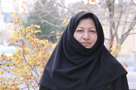 Sakineh Mohammadi Ashtiani, sentenced to death for adultery, poses for a picture in the yard of her home in Oskou, 570 km (354 miles) northwest of Tehran in this image released on December 9, 2010. REUTERS/PRESS TV