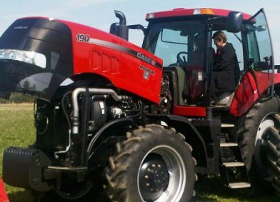 An NTC ag sciences student looks over a new Case IH tractor.  The college, Case IH and Service Motor Company signed a 10-year partnership April 14, 2010, that will provide ag science students with the latest Case IH farm equipment