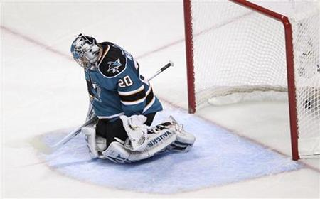 San Jose Sharks goalie Evgeni Nabokov reacts to letting in a goal by Chicago Blackhawks Patrick Sharp (not pictured) in the second period during Game 1 of their NHL Western Conference final series in San Jose, California May 16, 2010. REUTERS/Robert Galbraith