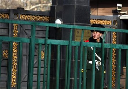 A paramilitary policeman stands guard outside the main gate of the North Korean embassy in central Beijing December 15, 2010. REUTERS/David Gray