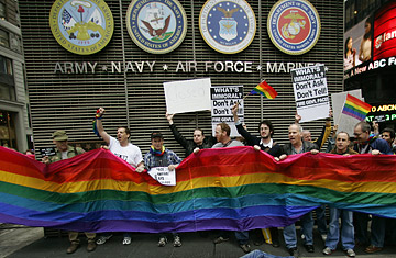 Demonstrators protest the military's Don't Ask, Don't Tell policy at a New York recruitment center. (Photo courtesy of Time.com/Getty).