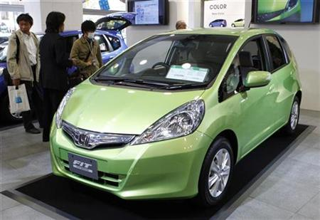 Honda Motor's all-new Fit Hybrid car is displayed at an unveiling event in Tokyo October 8, 2010. REUTERS/Issei Kato
