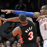 New York Knicks forward Amar'e Stoudemire (1) fouls Miami Heat guard Dwyane Wade during the first quarter of their NBA basketball game at Madison Square Garden in New York December 17, 2010. REUTERS/Ray Stubblebine