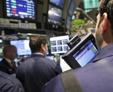 Traders on the floor of the New York Stock Exchange, January 22, 2009. REUTERS/Brendan McDermid