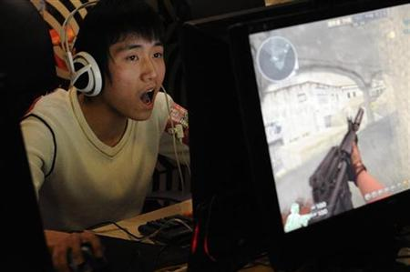 A gamer plays online games at an internet cafe in Taiyuan, Shanxi province, January 23, 2010. REUTERS/Stringer