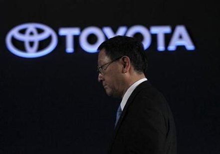 "Toyota Motor Corp President Akio Toyoda attends an unveiling of the company's redesigned compact car ""Vitz"" in Yokohama, south of Tokyo December 22, 2010. REUTERS/Toru Hanai"