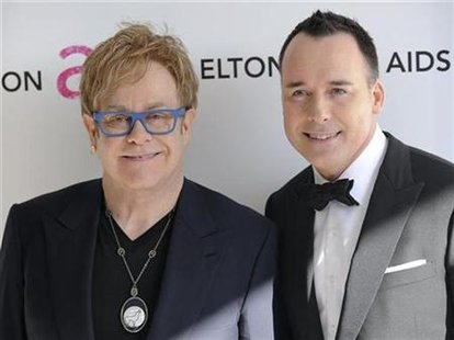Singer Elton John (L) and partner David Furnish arrive at the 18th Annual Elton John AIDS Foundation Academy Award Viewing Party in West Hollywood, California March 7, 2010. REUTERS/Gus Ruelas