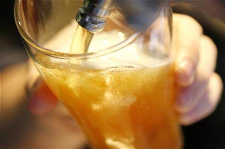 A bartender prepares a beer in a bar. REUTERS/Daniel Munoz