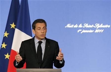 "France's President Nicolas Sarkozy delivers his New Year's speech to people who worked on New Year's Eve, at the Elysee Palace in Paris January 1, 2011. Message on background is ""Night of the New Year's Eve, Jan. 1, 2011"". REUTERS/Christophe Ena/Pool"
