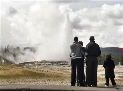 President Barack Obama, and his family visit the Old Faithful Geyser in Yellowstone National Park in Wyoming, August 15, 2009. REUTERS/Larry Downing