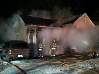 The Fond du Lac Fire Department worked to put out a house fire on Morris Avenue Friday night. (courtesy of FOX 11)
