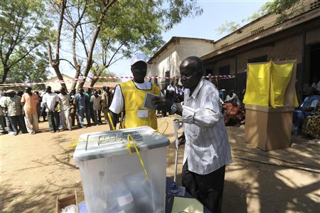 A southern Sudanese man casts his vote on the first day of polling in the independence referendum at Juba January 9, 2011. REUTERS/Tim McKulka/UNMIS/Handout