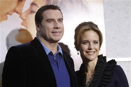 "Cast member Kelly Preston and her husband John Travolta pose at the premiere of ""The Last Song"" at the Arclight theatre in Hollywood, California March 25, 2010. The movie opens in the U.S. on March 31. REUTERS/Mario Anzuoni"
