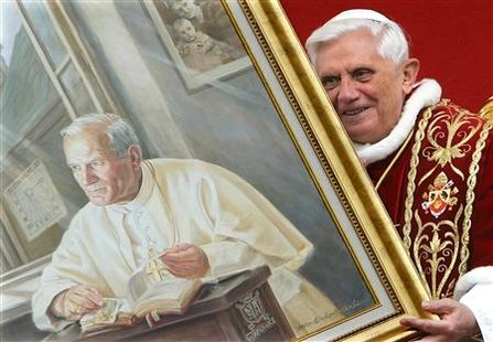 File photo of Pope Benedict XVI's holding a portrait of the late Pope John Paul II during a meeting with the faithful at Wadowice, Poland May 27, 2006. REUTERS/Max Rossi/Files