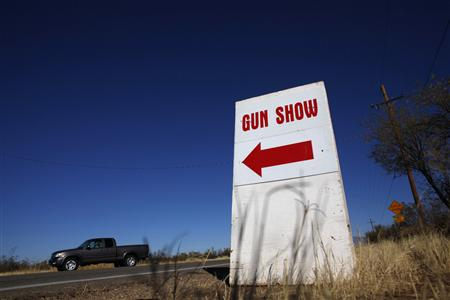 A sign advertises the Crossroads of the West Gun Show at the Pima County Fairgrounds in Tucson, Arizona January 15, 2011. REUTERS/Eric Thayer