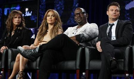 "Judges Steven Tyler (L), Jennifer Lopez (2nd L) and Randy Jackson and host Ryan Seacrest (R)take part in a panel discussion for the show ""American Idol"" at the Fox Broadcasting Company Winter Press Tour 2011 for the Television Critics Association in Pasadena, California January 11, 2011. REUTERS/Lucy Nicholson"