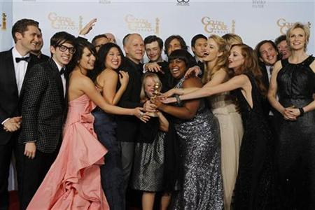 Ryan Murphy (5th L), creator of the TV series 'Glee', and cast members pose with the award for best television comedy series at the 68th annual Golden Globe Awards in Beverly Hills, California, January 16, 2011. REUTERS/Lucy Nicholson