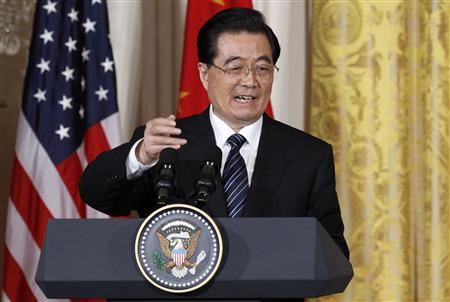 Chinese President Hu Jintao speaks during his joint news conference with U.S. President Barack Obama in the East Room of the White House in Washington, January 19, 2011. REUTERS/Jim Young