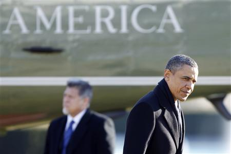 President Barack Obama is pictured upon upon returning from a day-trip to Schenetady, New York, at the South Lawn of the White House in Washington, January 21, 2011. REUTERS/Hyungwon Kang