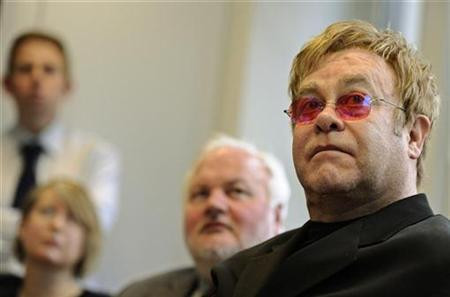 Britain's Elton John attends morning conference at The Independent newspaper editorial office, in London November 30, 2010. REUTERS/Dylan Martinez