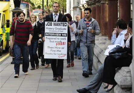 Jobless university graduate David Rowe wears a sandwich board advertising his search for employment as he walks along Fleet Street in central London, September 22, 2009. REUTERS/Kieran Doherty