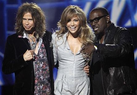 "Steven Tyler, Jennifer Lopez and Randy Jackson stand together after being announced as the judges for the 10th season of the television show ""American Idol"" at the Forum in Inglewood, California September 22, 2010. REUTERS/Mario Anzuoni"