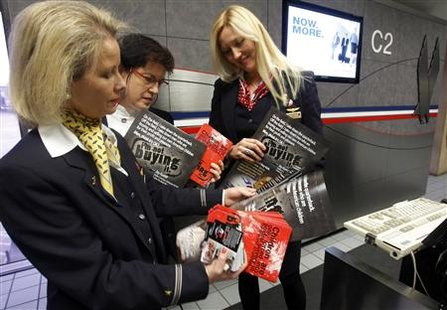 Flight attendants deliver educational materials about spotting sex-trafficking to a gate at the Dallas Fort Worth International Airport in Dallas, Texas, January 31, 2011 ahead of NFL's Super Bowl XLV to be played February 6. Pimps will traffic thousands of under-age prostitutes to Texas for Sunday's Super Bowl, hoping to do business with men arriving for the big game with money to burn, child rights advocates said. REUTERS/Brian Snyder