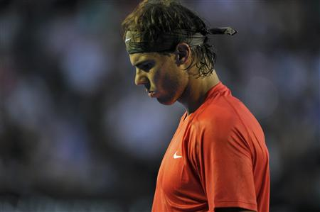 Rafael Nadal of Spain reacts during his quarter-final match against compatriot David Ferrer at the Australian Open tennis tournament in Melbourne January 26, 2011. REUTERS/Paul Crock/Pool