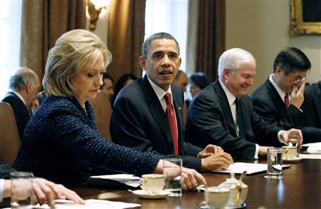 President Barack Obama participates in a cabinet meeting in the West Wing of the White House in Washington, February 1, 2011. Alongside Obama is Secretary of State Hillary Clinton (L), Defense Secretary Robert Gates (2nd R) and Commerce Secretary Gary Locke. REUTERS/Jason Reed