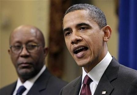 President Barack Obama speaks on the U.S.-South Korea trade agreement next to Trade Representative Ron Kirk at the Eisenhower Executive Office Building in Washington December 4, 2010. REUTERS/Yuri Gripas