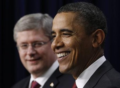 U.S. President Barack Obama (R) and Canadian Prime Minister Stephen Harper attend a joint news conference in the Eisenhower Executive Office Building in Washington, February 4, 2011. REUTERS/Jim Young