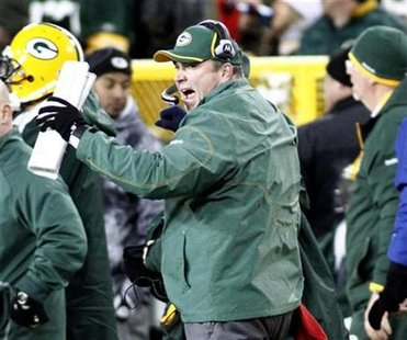 Green Bay Packers head coach Mike McCarthy reacts after a play against the New York Giants in the second half of their NFL football game in Green Bay, Wisconsin December 26, 2010. REUTERS/Darren Hauck