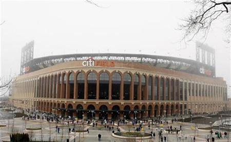 Baseball fans arrive at the Mets' new stadium, Citi Field, before a Major League Baseball exhibition baseball game between the New York Mets and the Boston Red Sox in New York April 3, 2009. REUTERS/Lucas Jackson