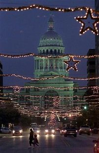 The Texas state capitol building is framed in Christmas lights in Austin, December 23, 2000. REUTERS/Adrees A.