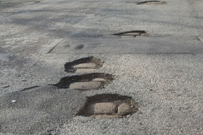 Potholes On A Road