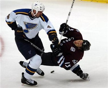 St. Louis Blues Eric Brewer drops Colorado Avalanche Dan Hinote with a left hook and gets called for roughing during their NHL game in Denver, Colorado January 9, 2006. REUTERS/Mark Leffingwell