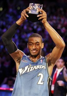 Rookie team's John Wall of the Washington Wizards holds up the MVP trophy after the Rookie team beat the Sophomores during the Rookie Challenge as part of NBA All-Star weekend in Los Angeles, California, February 18, 2011. REUTERS/Lucy Nicholson