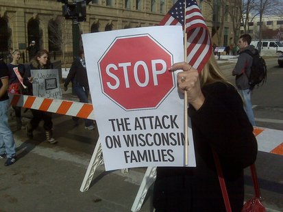 A protester holds a sign outside the state Capitol on Wednesday, Feb. 16, 2011, in Madison. (courtesy of FOX 11)