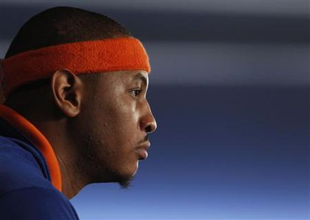 New York Knicks' Carmelo Anthony listens to a question at a news conference held to introduce him as one of the newest members of the Knicks, after being acquired from the Denver Nuggets in a trade, at Madison Square Garden in New York, February 23, 2011. REUTERS/Jessica Rinaldi