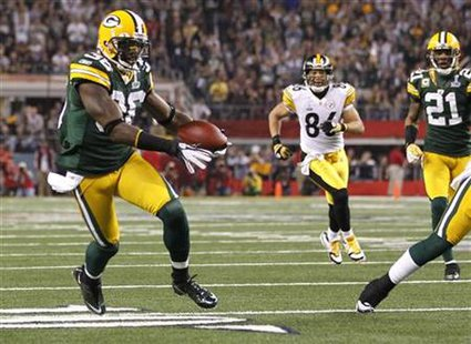 Green Bay Packers safety Nick Collins (36) runs back an interception for a touchdown against the Pittsburgh Steelers in the first quarter during the NFL's Super Bowl XLV game in Arlington, Texas, February 6, 2011. Representatives of the National Football League and its players' union met Thursday to try and thrash out a last-minute labor deal and avoid a possible lockout next season. REUTERS/Mike Stone