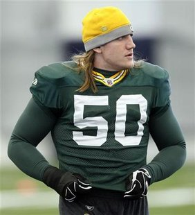 Green Bay Packers linebacker A.J. Hawk looks on before the start of practice for Super Bowl XLV in Dallas, Texas February 2, 2011. REUTERS/Jeff Haynes