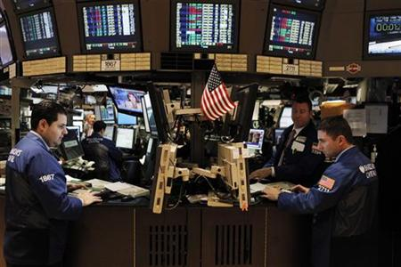 Specialists work on the floor of the New York Stock Exchange March 3, 2011. REUTERS/Lucas Jackson