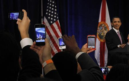 Democratic Party donors take pictures of U.S. President Barack Obama with their cellphones during a Democratic Party fundraiser in Miami March 4, 2011. REUTERS/Jason Reed