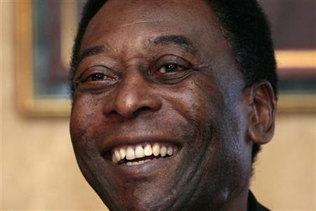 Brazilian soccer legend Pele smiles during a news conference in Hong Kong March 7, 2011. REUTERS/Tyrone Siu