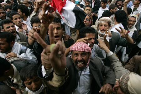 Anti-government protesters shout slogans after clashes with police in Sanaa March 12, 2011. REUTERS/Khaled Abdullah
