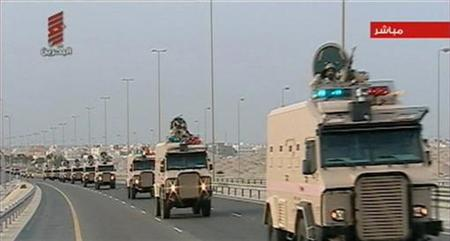 Saudi Arabian troops cross the causeway leading to Bahrain in this still image taken from video March 14, 2011. REUTERS/Bahrain state TV via Reuters TV