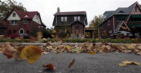 Fall leaves blow past an empty home (C) seen in a well kept neighborhood where the house is listed on the auction block during the Wayne County tax foreclosures auction of almost 9,000 properties in Detroit, Michigan, October 22, 2009. REUTERS/Rebecca Cook