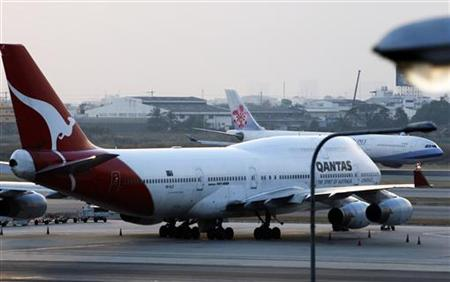 A Qantas Airways Boeing 747 is seen parked at Bangkok's Suvarnabhumi airport January 26, 2011. REUTERS/Sukree Sukplang