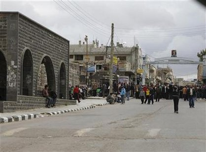 Protestors gather near the Omari Mosque in the southern old city of Deraa March 22, 2011.REUTERS/Khaled al-Hariri